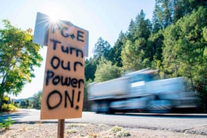 A road sign calls for PG&E to turn the power back on in Calistoga, California.