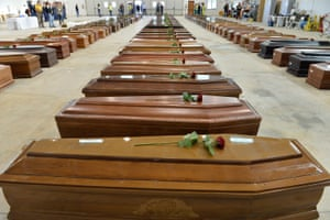 Coffins of some of the African migrants killed in a shipwreck off the Italian coast in 2013