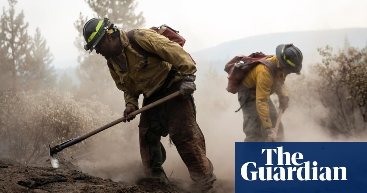 Wildfire fighters advance against biggest US blaze amid dire warnings