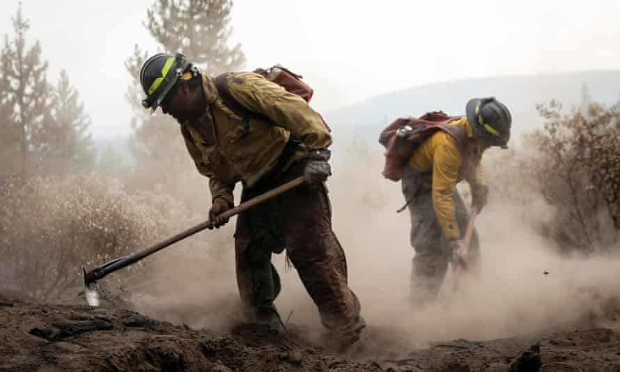 Firefighters from New Mexico work amidst heavy ash and dust to help contain the Bootleg fire near Silver Lake, Oregon.
