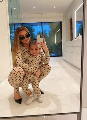 Kylie Jenner and daughter Stormi wearing matching Serre catsuits.