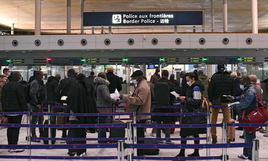 Travellers at Charles-de-Gaulle airport near Paris