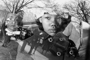 Coretta Scott King and her daughter, Yolanda, sit in a car as it leaves for King's funeral, in Atlanta, Georgia on 9 April 1968.