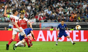 Olivier Giroud of Chelsea scores his team's first goal as he is challenged by Laurent Koscielny of Arsenal.