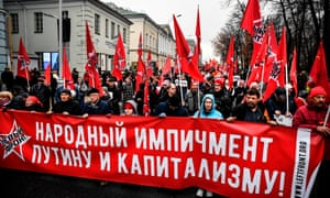 Communist party supporters march in central Moscow on November 7, 2019