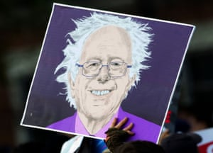 An illustration of Sanders is brandished at the Washington Square Park event