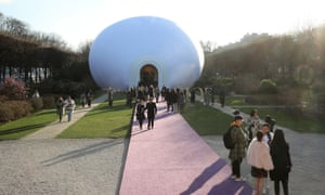 Guests outside a custom version of Judy Chicago's Inflatable Mother Goddess, first proposed in 1977.