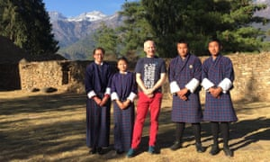 students and author in front of mountain backdrop