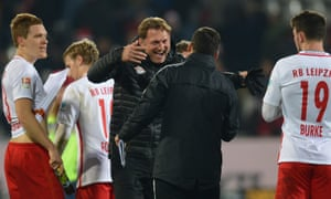 Head coach Ralph Hasenhuettl celebrates with his team after the 4-1 Bundesliga win at Freiburg.