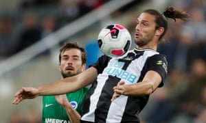 Newcastle United's Andrew Carroll controls the ball.