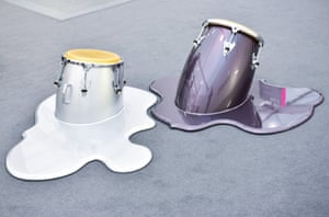 A work in which bongo drums seem to sink into the carpet.