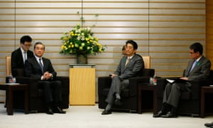 Chinese Foreign Minister Wang Yi, second from left, sits with Japanese Prime Minister Shinzo Abe, second from right, and Japanese Foreign Minister Taro Kono for their meeting at Abe's official residence in Tokyo.