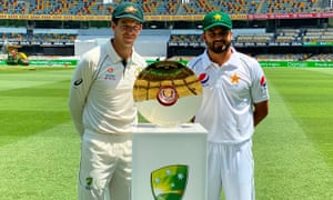 Australia's captain Tim Paine and Pakistan skipper Azhar Ali posing with the series trophy at the Gabba.