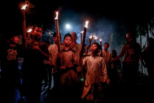 Children carry torches during a parade to welcome the Muslim holy month of Ramadan
