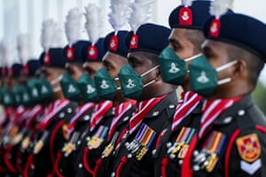 Sri Lanka army personnel form a guard of honour for the visit of India's chief of army staff to their HQ