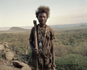 Sixty-eight-year-old Alagu carries his axe to look for honey inside the trees