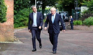 Prime Minister Boris Johnson is greeted by Northern Ireland Secretary Julian Smith at Stormont House.