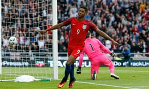 Marcus Rashford celebrates after scoring his first goal for England.
