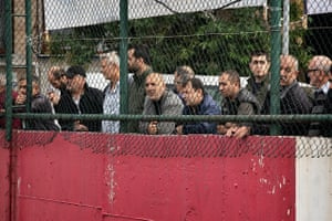 Turkish soccer fans watching the match from the outside of the Feriköy Stadium.