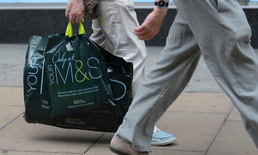 someone carrying m&s bags