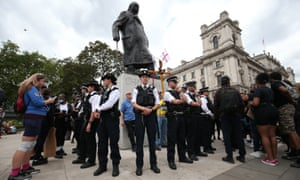 Police form up around the Sir Winston Churchill statue in Parliament Square, London, ahead of a rally at the Nelson Mandela statue in the square to commemorate George Floyd