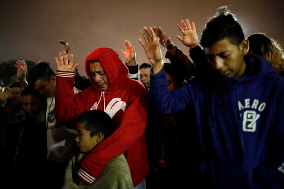 A moment of prayer near the San Ysidro checkpoint