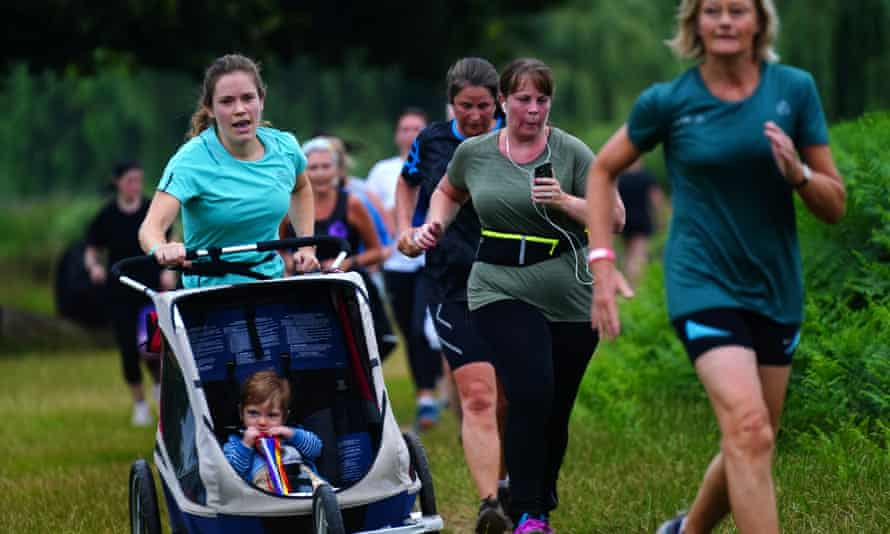 Runners, plus pushchairs, take part in the event at Bushy Park, where parkrun was founded.