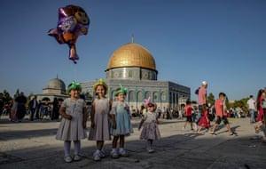 East Jerusalem: Palestinians arrive to perform Eid al-Adha prayer at al-Aqsa mosque complex