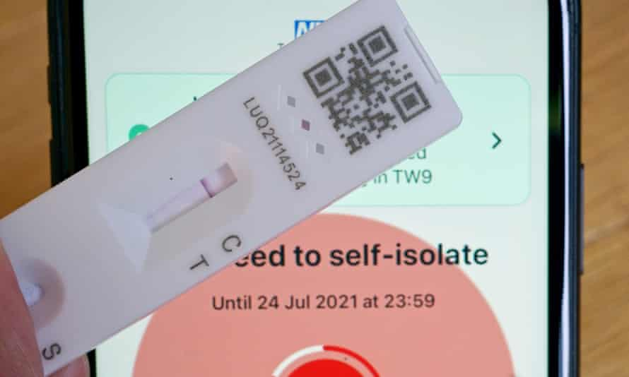 A negative lateral flow test next to advice from the NHS app to self-isolate