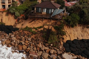 A cliffside home in Wamberal, NSW, is at risk of being swept away after days of driving rain, high winds and monster swells.