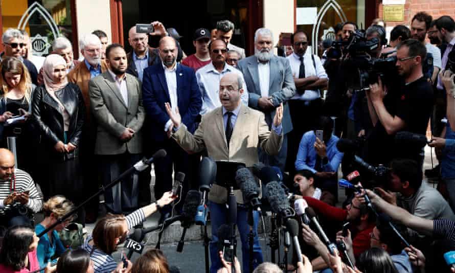 Fawzi Haffar, a trustee at the Didsbury mosque, speaks to journalists.