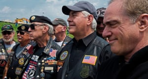 US Secretary of State Rex Tillerson (C) stands withRolling Thrunder, Inc., founder Artie Muller (3rd-R) L) and US Secretary of Veterans Affairs Dr. David J. Shulkin (R) as opening remarks are delivered at the Pentagon of Washington, DC, in honor of Memorial Day