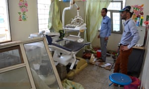 People inspect the damage in a room at an hospital operated by the the Paris-based aid agency, Doctors Without Borders in Abs.