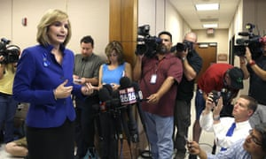 The Harris County district attorney, Devon Anderson, explains outside state district court court on Monday how sheriff's deputy Darren Goforth was gunned down.