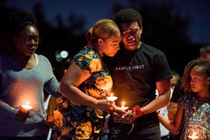 Las Vegas, US. The family of the police officer Charleston Hartfield, who was killed in a mass shooting at the Route 91 Harvest music festival on Sunday, attend a candlelit vigil at the city's Police Memorial park