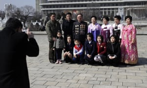 A North Korean family has their photo taken as they mark the International Women's Day in Pyongyang, North Korea.