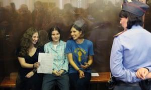 Mariya Alyokhina (left) with fellow Pussy Riot members Yekaterina Samutsevich and Nadezhda Tolokonnikova at their sentencing in Moscow, 17 August 2012.