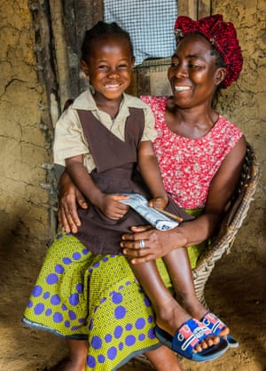 Blessing Johnson, whose parents died of Ebola soon after she was born, with her aunt Zoe.