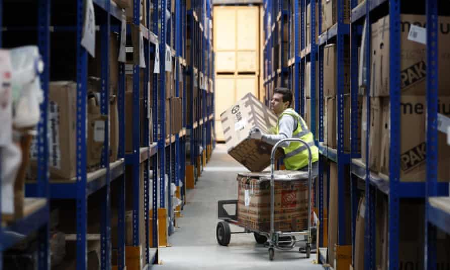 Lovespace warehouse worker Pawel Mazur unloads boxes from a trolley