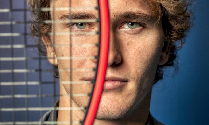 A close-up of Alex Zverev's face with the left half obscured by a tennis racquet