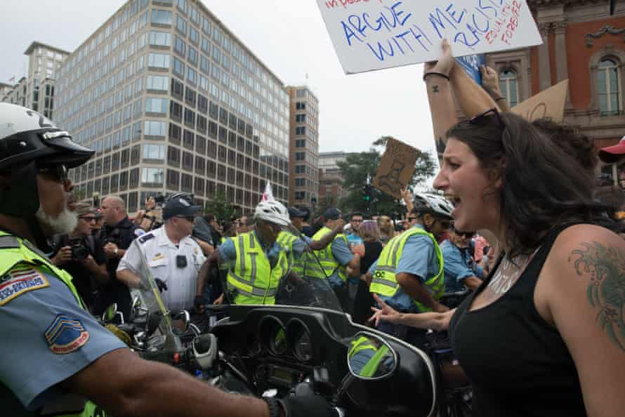 A counter protester remonstrates with a police motorcyclist who was escorting the nationalists.