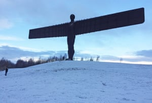 Snow dusts the Angel of the North sculpture in Gateshead