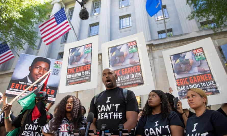 Black Lives Matter of Greater New York protest in support of an indictment for the death of Eric Garner<br>epa07719377 Hawk Newsome (C) of Black Lives Matter of Greater New York speaks a protest at the US Department of Justice building in support of an indictment for the death of Eric Garner in Washington, DC, USA, 15 July 2019. Eric Garner died 17 July 2014 during a confrontation with officers of the New York City Police Department. The group is calling for NYPD officer Daniel Pantaleo to be charged in Garner's death. The federal statute of limitation in the Garner case expires 17 July 2019. EPA/ERIK S. LESSER
