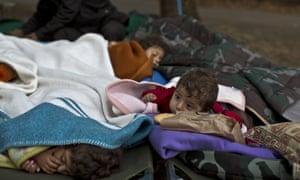 Yazidi refugee children from Mosul, Iraq, sleep with their family near an abandoned military barrack in Beli Manastir, north-east Croatia.