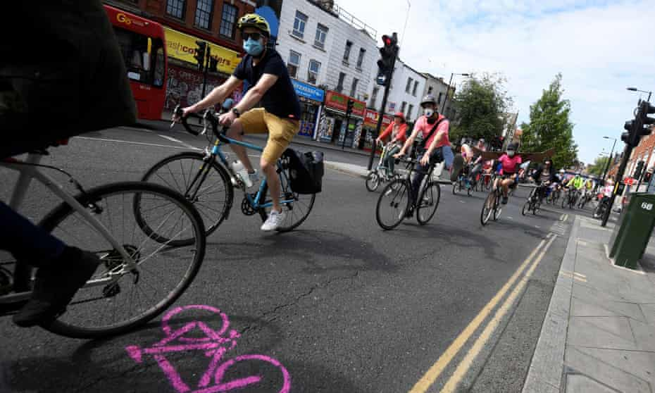 An Extinction Rebellion bike ride calling for more cycling and cycle lanes, London, May 2020