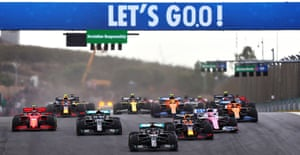 Lewis Hamilton leads the way as the race begins.