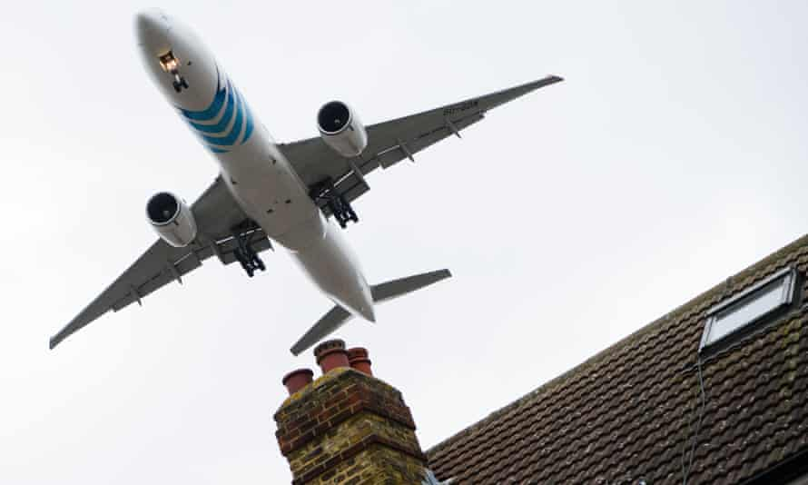 An aircraft flying over houses in Hounslow as it prepares to land at London Heathrow airport.
