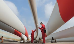 Workers inspect wind turbine blades in Lianyungang, China