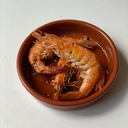 Back up to me, Clive: plenty of dry sherry in Keith Floyd's garlic prawns.