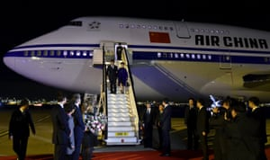 Chinese President Xi Jinping and his wife Peng Liyuan leave their plane as they arrive at Heathrow Airport